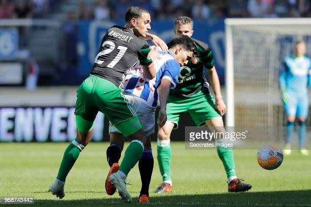 Sofyan Amrabat of Feyenoord Yuki Kobayashi of SC Heerenveen during the Dutch Eredivisie match between SC Heerenveen v Feyenoord at the Abe Lenstra...