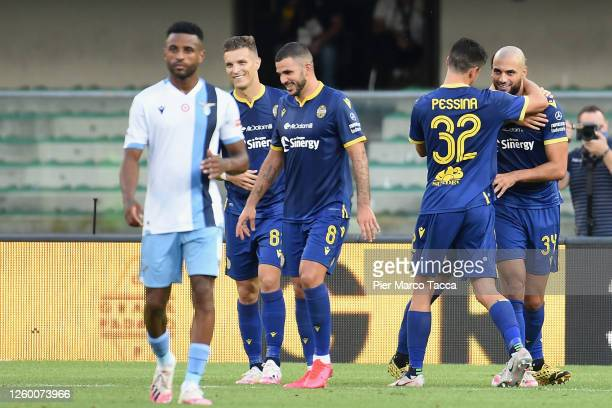 Sofyan Amrabat of Hellas Verona celebrates his first goal with Matteo Pessina during the Serie A match between Hellas Verona and SS Lazio at Stadio...
