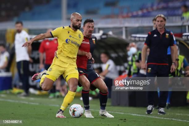 Sofyan Amrabat of Hellas Verona clashes with Filip Jagiello of Genoa CFC during the Serie A match between Genoa CFC and Hellas Verona at Stadio Luigi...