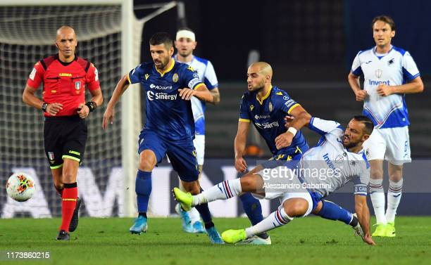 Sofyan Amrabat of Hellas Verona competes for the ball with Fabio Quagliarella of UC Sampdoria during the Serie A match between Hellas Verona and UC...