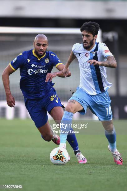 Sofyan Amrabat of Hellas Verona competes for the ball with Luis Alberto of SS Lazio during the Serie A match between Hellas Verona and SS Lazio at...