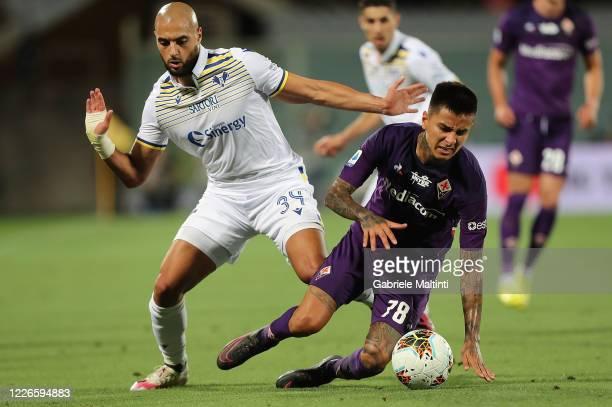 Sofyan Amrabat of Hellas Verona in action against Erick Pulgar of ACF Fiorentina during the Serie A match between ACF Fiorentina and Hellas Verona at...