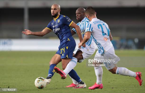 Sofyan Amrabat of Hellas Verona is challenged by Bryan Dabo of Spal during the Serie A match between Hellas Verona and SPAL at Stadio Marcantonio...