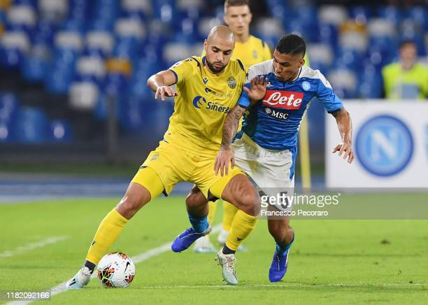 Sofyan Amrabat of Hellas Verona vies with Allan of SSC Napoli during the Serie A match between SSC Napoli and Hellas Verona at Stadio San Paolo on...