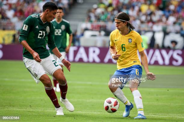 Sofyan Amrabat of Morocco and Filipe Luis from Brazil during a game between Brazil and Mexico valid for the eighth round of World Cup 2018 finals...