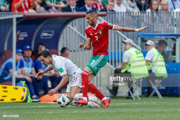 Sofyan Amrabat of Morocco and Hakim Ziyech of Morocco battle for the ball during the 2018 FIFA World Cup Russia group B match between Portugal and...
