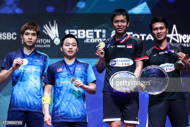 Soh Wooi Yik Aaron Chia of Malaysia and Hendra Setiawan Mohammad Ahsan of Indonesia pose with their trophies after the Men's Double final match...