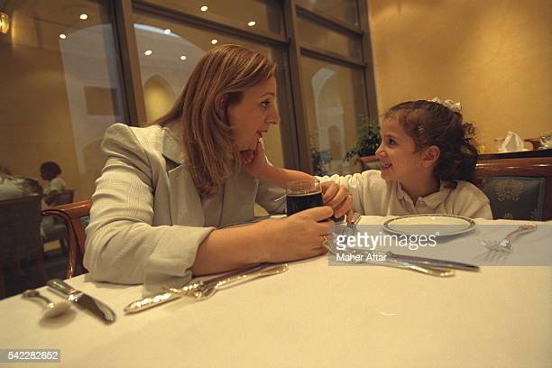 Soha and her daughter at a dinner table