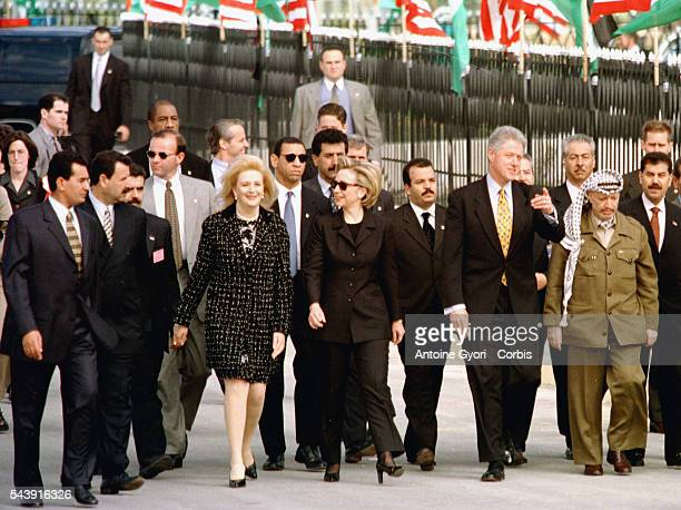 Soha and Yasser Arafat welcome Bill and Hillary Clinton at Rafah/Gaza international airport.