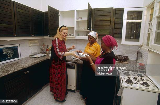 Soha Arafat and Domestic Workers in Kitchen