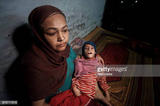 Sohaib 10 years old with his mother Firoza at home in the Tila Jamalpura neighborhood Sohaib was born to parents contaminated by a carcinogenic and...