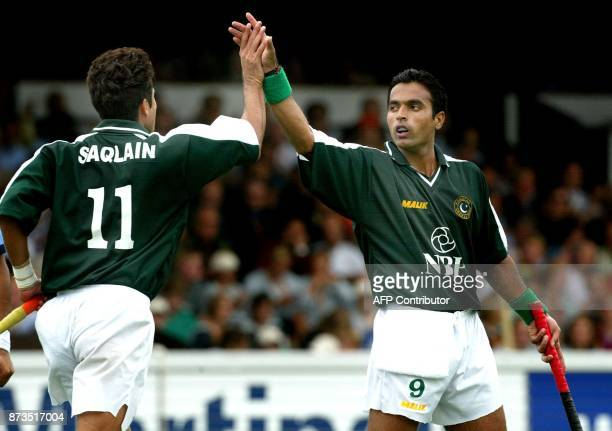 Sohail Abbas has scored for Pakistan and gets a high five from teamplayer Mahammad Saqlain Sunday 24 August 2003 during the match for the 3rd place...