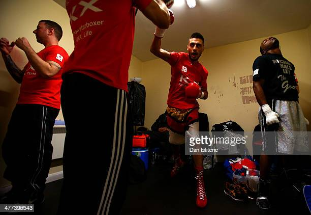 Sohail Ahmad prepares with his trainer next to Justin Menzie in the changing rooms before his Light Welterweight bout against Ivans Levickis at York...