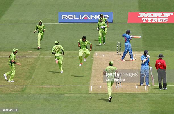 Sohail Khan of Pakistan celebrates after dismissing Rohit Sharma of India during the 2015 ICC Cricket World Cup match between India and Pakistan at...