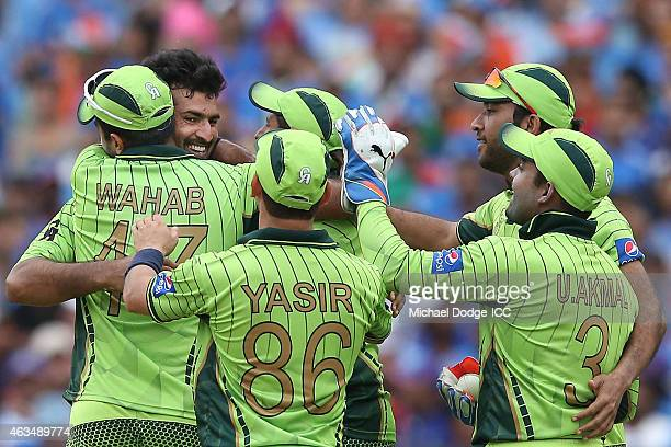 Sohail Khan of Pakistan celebrates his 5th wicket with teamates during the 2015 ICC Cricket World Cup match between India and Pakistan at Adelaide...