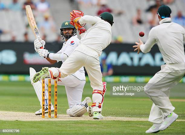 Sohail Khan of Pakistan plays a sweep shot that goes past Steve Smith of Australia during day three of the Second Test match between Australia and...