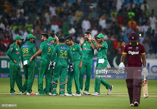 Sohail Tanvir of Pakistan celebrates wirh teammates after dismissing Evin Lewis of West Indies during the second T20 International match between...
