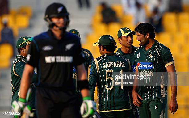 Sohail Tanvir of Pakistan celebrates with teammates after dismissing Martin Guptill of New Zealand during the 4th One Day International match between...
