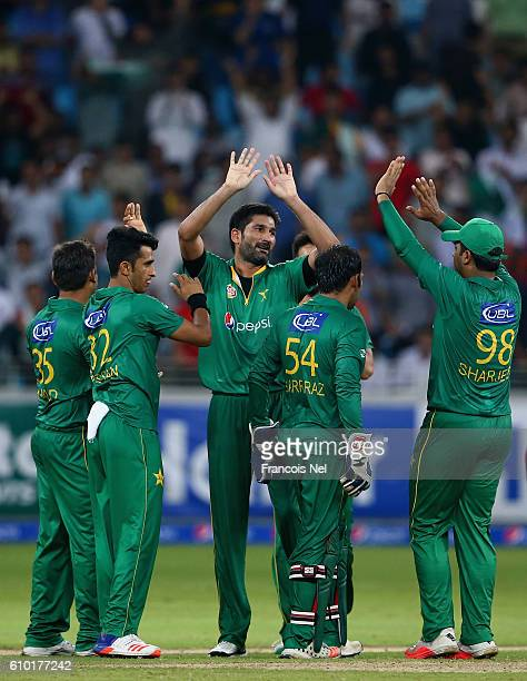 Sohail Tanvir of Pakistan celebrates with teammates after dismissing Nicholas Pooran of West Indies during the second T20 International match between...