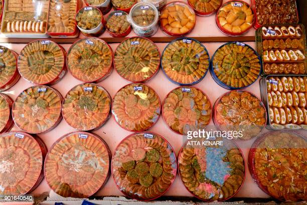 Sohan an Iranian sweet is displayed at a shop near the Massoumeh shrine in the holy city of Qom 130 kilometres south of Tehran on December 14 2017 /...