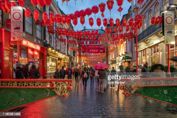 soho, chinatown on a rainy evening, london, uk - london stock pictures, royalty-free photos & images