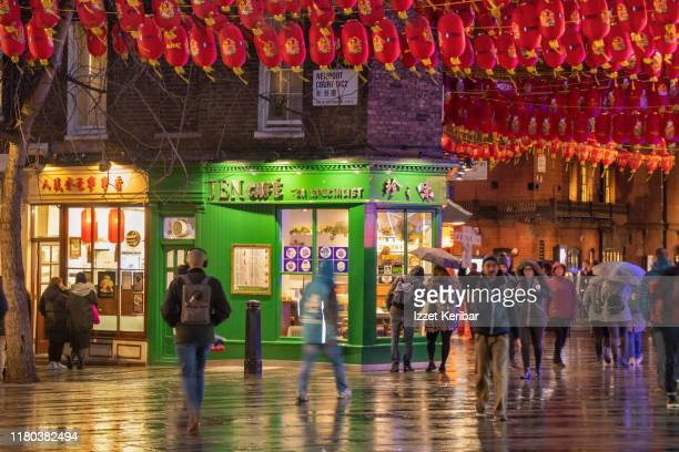 soho, chinatown on a rainy evening, london, uk - editorial stock pictures, royalty-free photos & images