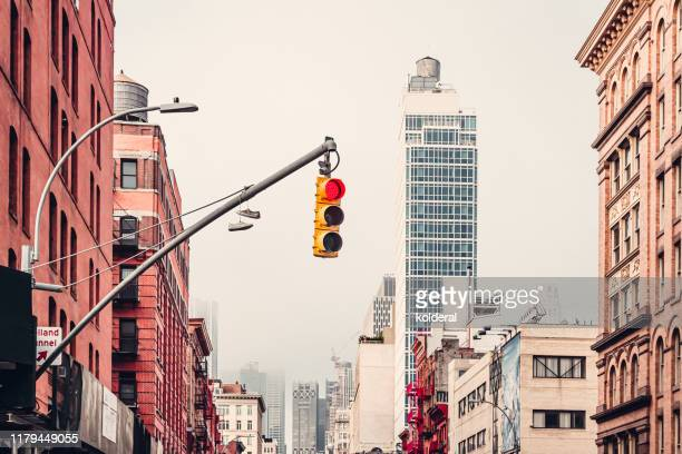 soho district street early morning , manhattan , new york - road signal stock pictures, royalty-free photos & images