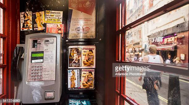 Soho, typical telephone box with sexual ads