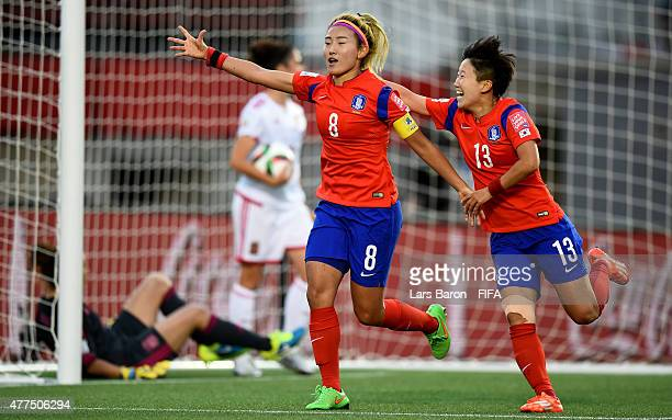Sohyun Cho of Korea celebrates with Hahnul Kwon of Korea after scoring her teams first goal during the FIFA Women's World Cup 2015 Group E match...