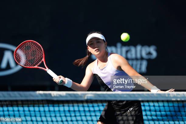 Sohyun Park of Korea and Hong Yi Cody Wong of Hong Kong compete in their first round Junior Girls Doubles match against Alice Amendola and Zoziya...