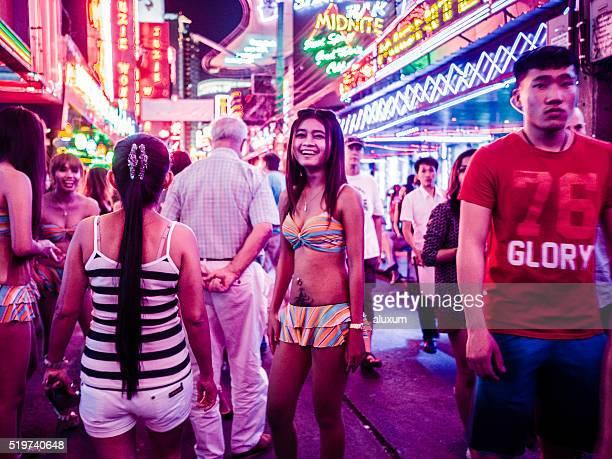 soi cowboy red light district bangkok thailand - bangkok stock photos and pictures
