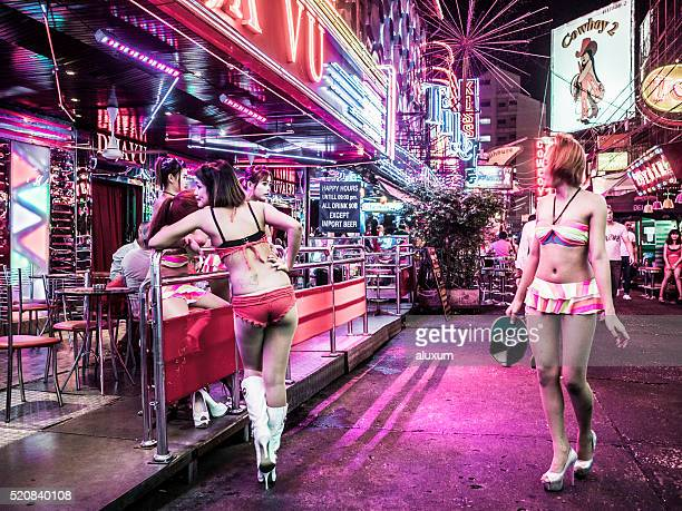 soi cowboy red light district bangkok thailand - thailand prostitutes stock photos and pictures