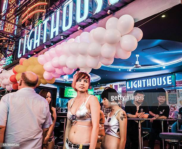soi cowboy red light district in bangkok thailand - old man young woman stock photos and pictures