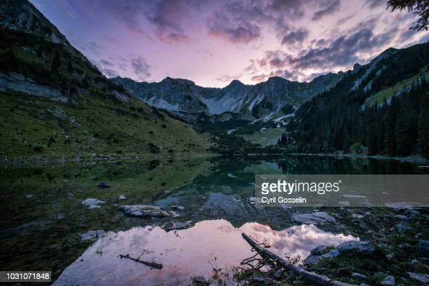 soierngruppe mountain range at twilight - dämmerung stock pictures, royalty-free photos & images