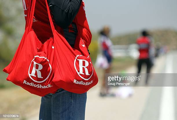 Soigneur for Radio Shack holds musette bags in the feed zone during Stage Six of the 2010 Tour of California from Palmdale to Big Bear on May 21,...