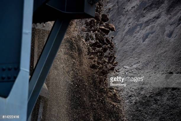 Soil and brown coal fall from the bucket wheel of a giant excavator during mining operations at the Garzweiler open cast lignite mine operated by RWE...