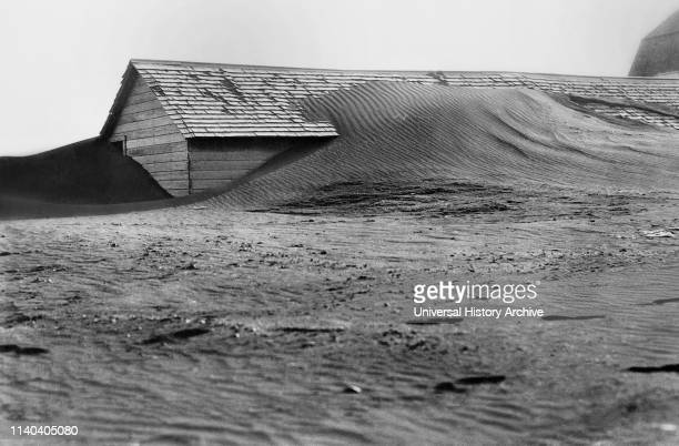 Soil Drifting over Hog House, South Dakota, USA, Rosebud Photo, Farm Security Administration, 1935.