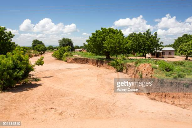 Soil on the edge of a river washed away by the Malawi floods.