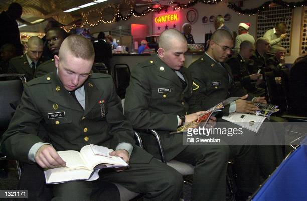 S Soilder recruits from Fort Leonard Wood read and relax at the USO December 21 2000 at LambertSt Louis International Airport as they wait for...