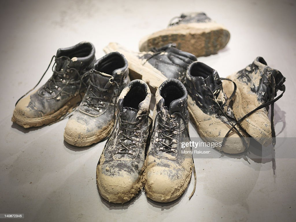 Soiled boots of workmen from a quarry : Stock Photo