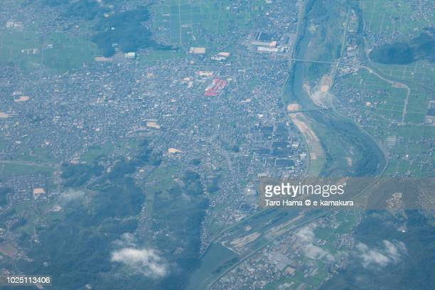 Soja city in Okayama prefecture in Japan daytime aerial view from airplane
