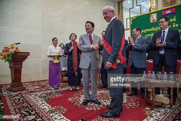 Sok An Deputy Prime Minister of Cambodia and Walter Timoshuk President of the Norton Simon Museum pose for a photograph during a handover ceremony at...