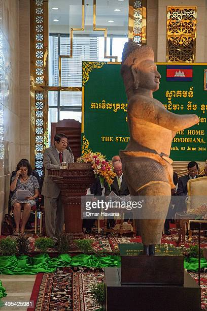 Sok An Deputy Prime Minister of Cambodia gives a speech in front of the Bhima statue returned by the Norton Simon Museum to Cambodia during a...