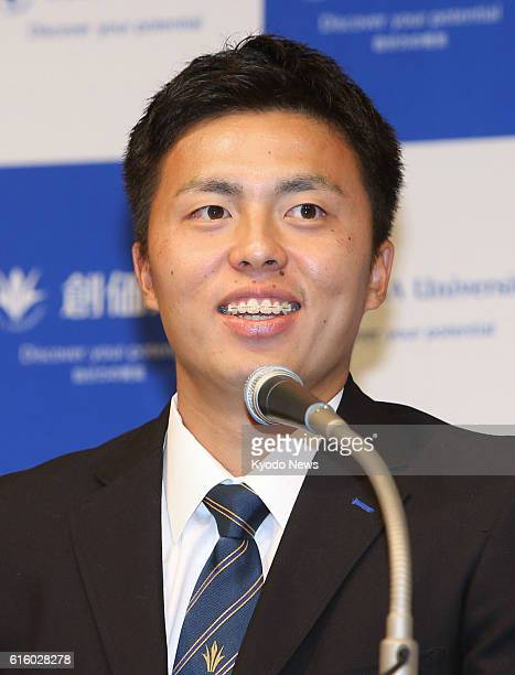 Soka University righthander Seigi Tanaka speaks at a press conference in Tokyo on Oct 20 after the SoftBank Hawks won the exclusive right to...