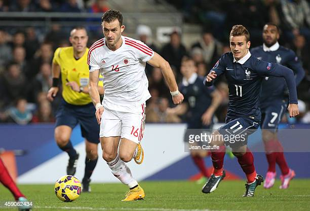 Sokol Cikalleshi of Albania and Antoine Griezmann of France in action during the international friendly match between France and Albania at Stade de...