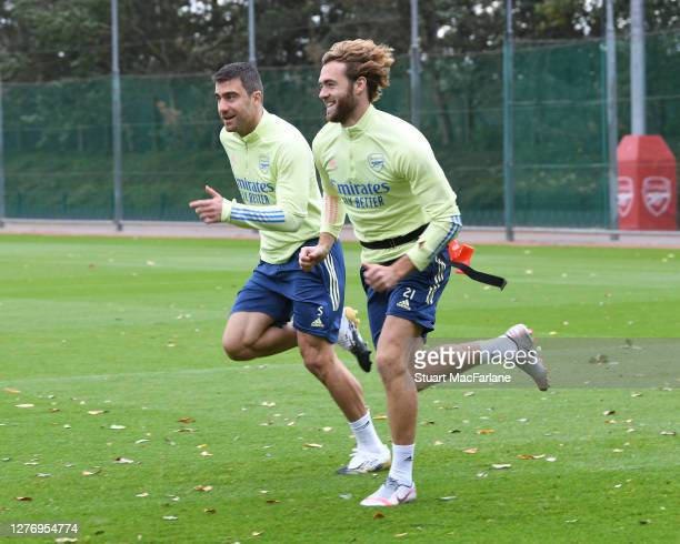 Sokratis and Calum Chambers of Arsenal during a training session at London Colney on September 27 2020 in St Albans England