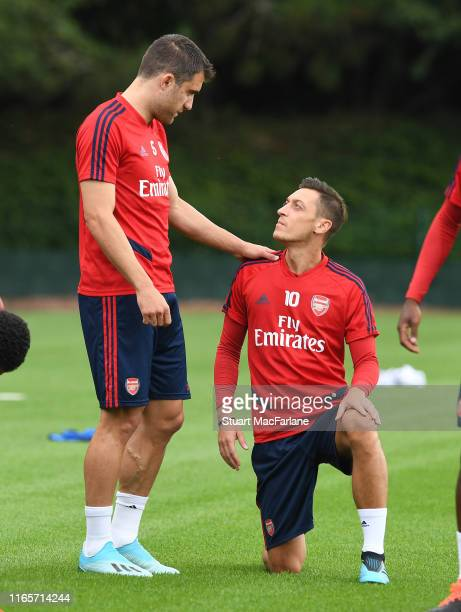 Sokratis and Mesut Ozil of Arsenal during a training session at London Colney on August 02, 2019 in St Albans, England.