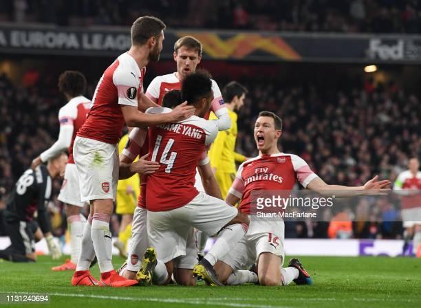 Sokratis celebrates scoring the 3rd Arsenal goal with Shkodran Mustafi PierreEmerick Aubameyang and Stephan Lichtsteiner during the UEFA Europa...