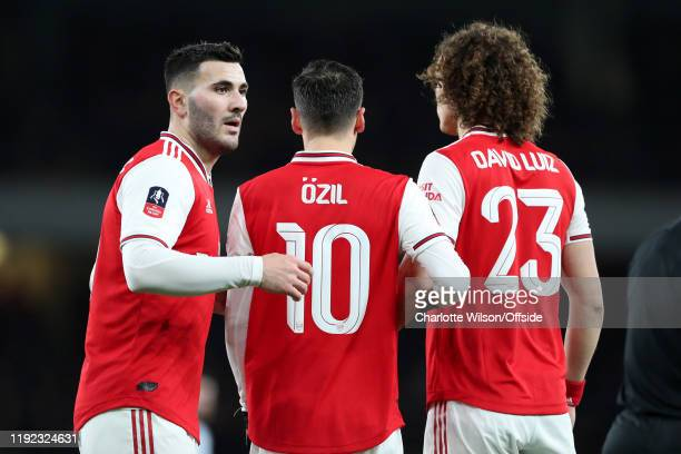 Sokratis Mesut Ozil and David Luiz of Arsenal form a defensive wall during the FA Cup Third Round match between Arsenal and Leeds United at Emirates...