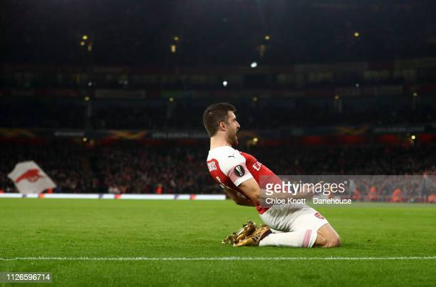 Sokratis of Arsenal celebrates scoring his team third goal during the UEFA Europa League Round of 32 Second Leg match between Arsenal FC and Bate...